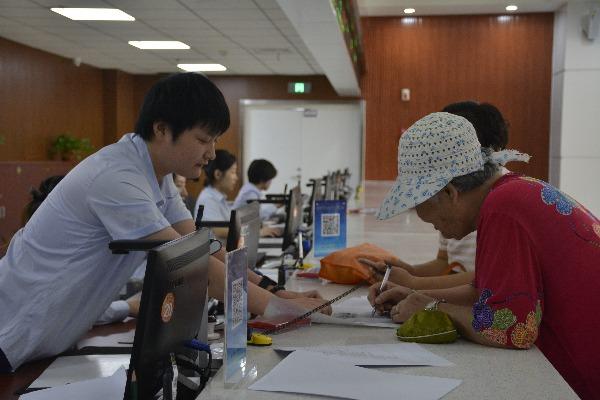 济宁市不动产登记中心设三联办窗口 市民办业务更快了