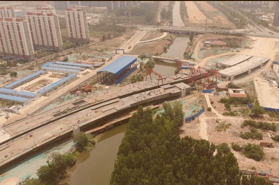 车站南路跨老运河桥主跨合龙拼接完成 预计9月下旬通车